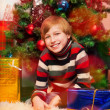 Cute happy boy waiting for presents opening — Stock Photo