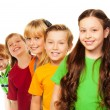 Five happy kids standing in a line — Stock Photo
