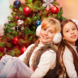 Two sisters celebrating Christmas — ストック写真