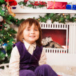 Five year old boy sitting by Christmas tree — Stock Photo