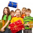 Happy kids with Christmas presents — Stockfoto