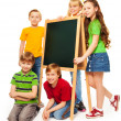 Group of schoolboys and schoolgirls with blackboard — Stock Photo