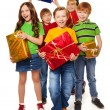Boys and girls with Christmas gifts — Stockfoto
