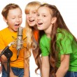 Boys and girls singing - Stock Photo