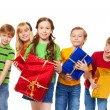 Cute kids with wrapped boxes — Stock Photo