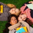 Three girls laying in park — Stock Photo