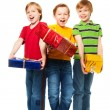 Laughing boys with presents — Stock Photo