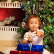 Little girl sitting with presents — Stock Photo