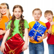 Stock Photo: Funny kids holding presents