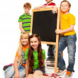 Five kids with blackboard — Stock fotografie