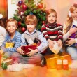 Happy friends together at Christmas Eve — Stockfoto