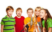Group of 8 years old kids with microphone — Stock Photo
