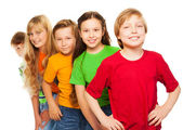 Five happy kids in colorful shirts — Stok fotoğraf