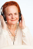 Old lady listening to music — Stock Photo