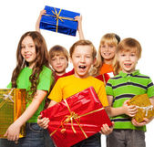 Happy kids with Christmas presents — Stock Photo