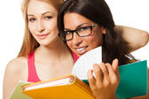 Two students with note pads — Stock Photo