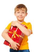 Boy holding his Christmas present — Stock Photo