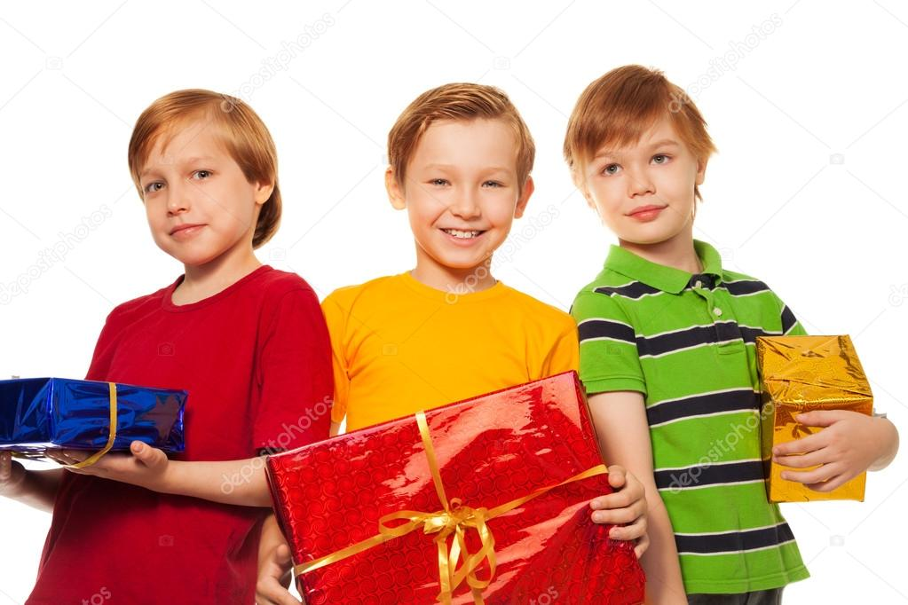 Three happy friends with presents isolated on white  Stock Photo #16295015