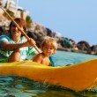 Sea kayaking with children - Stock Photo