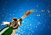 Champagne plash and snow — Stock Photo