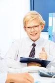 Kid pretending to be a boss — Stock Photo