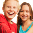 Laughing teen boy and girl — Stock Photo