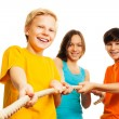 Stock Photo: Three kids pull rope