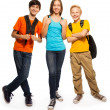 Stock Photo: Happy teen kids with backpacks