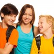 Teen girl hugging her two friends — Stock Photo
