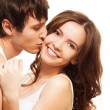 Young man kissing girl — Stockfoto
