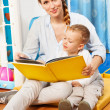 Stock Photo: Reading to children