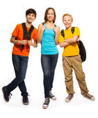 Happy teen kids with backpacks — Stock Photo
