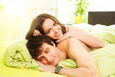 Happy couple in the bed — Stock Photo
