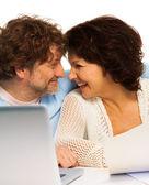 Senior couple and PC — Stock Photo