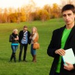 Confident student with friends — Stock Photo