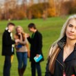 One girl student with friends on background — Stock Photo