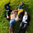 Four laying on the grass — Foto Stock