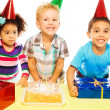 Eating cake and receiving presents — Stock Photo #22245911