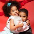 Loving siblings hugging - Stock Photo