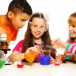 Three kids and chemistry lab — Stock Photo