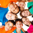 Circle of kids looking down — Stock Photo #22246415