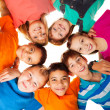Circle of happy kids together smiling — Stock Photo #22246419