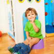 Foto Stock: Learning to use potty