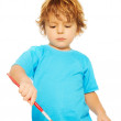 Occupied little boy painting — Stock Photo