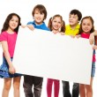 Kids showing blank placard — Stockfoto