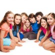 Boys and girls sitting together in semi-circle — Stock Photo