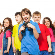 Happy boy with binoculars in a group — Stock Photo