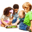 Four little kids playing tablet — Stock Photo #22247023