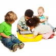 Four kids playing tablet computer — Stock Photo #22247029