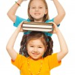 Smart girls with pile of books — Stockfoto